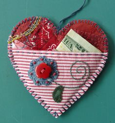 ~The Love Pocket - Angie's Bits n Pieces ~ Note To Self: Looks like you just cut out 2 heart shapes from felt or other fabric, then blanket stitch tog w/another fabric for the pocket. Add creative embellishments.