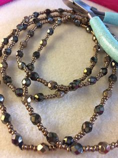 8c2af571a A simple, yet beautiful firepolish and seed beads necklace. Extra long  length in amazing bronze tones.