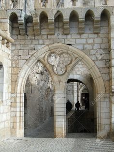 Mullioned window and arch, Romanesque church and shrines atop the citadel, in Rocamadour, France