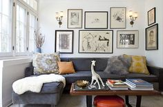 Small space, how the couch fits, arrangement of pictures, sconces and coffee table.