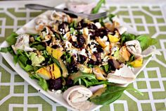 Spinach Arugula Pears or apples Roasted beets Dried cranberries Walnuts or sliced almonds Avocado Goat Cheese Deli turkey Aged balsamic (and today I also used a little honey mustard…love to mix!)