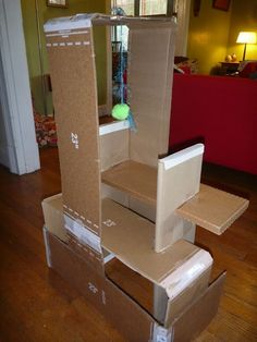 DIY cardboard cat house (via ModernJune)
