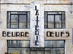 """""""Art deco is a modern style characterized by streamlined, geometric compositions and a sophisticated, machine-age look. The spectacular façade for a laiterie (dairy) is a designated landmark (despite the tea shop that happens to currently inhabit the space.)"""""""