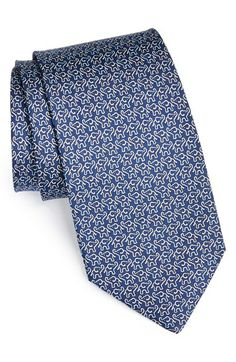 Salvatore Ferragamo Elephant Print Tie.  A charming elephant print defines a sharp novelty tie cut from pure silk.