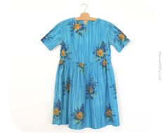 Items similar to Vintage flower dress from the blue vintage dress, blue flower dress from the on Etsy Short Sleeve Dresses, Dresses With Sleeves, Flower Dresses, Vintage Flowers, 1950s, Vintage Outfits, Trending Outfits, Unique Jewelry, Blue