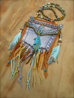 custom make DENIM medicine bag tribal american INDIAN medicine bag with FEATHER charm turquoise suede leather beaded necklace. $96.00, via Etsy.