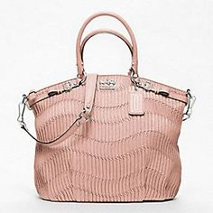 """Not really a fan of """"new"""" Coach, but love this bag in this color."""