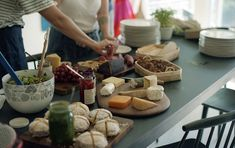 by Melinda Josie  lots of different cheeses, fruits, olives, crackers and breads..don't forget several wines, and that's a great party idea.