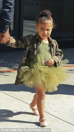 Let's dance: North wore a green leotard with a frilly tulle skirt to match along with pale pink ballet slippers