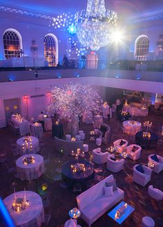 This dreamy Winter Wonderland affair is sure to make your heart melt. The cobalt blue, snow white, and warm ecru color palette paired with fresh pine garlands, a festive silver tree, and every type of white tulip imaginable were the perfect ingredients needed to create this magical evening. The stag