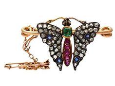 BROOCH bronze/silver, butterfly, rose cut diamonds, rubies, emerald and sapphires, length approx 3 cm, weight 5,1 g.