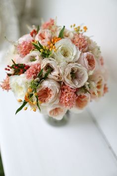 Stunning peachy-pink wedding bouquet with Juliet, Charity and Patience from the David Austin roses collection.