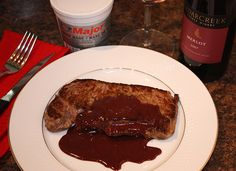 chef dezs new york strip steaks with merlot reduction