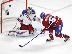 Max Pacioretty of the Montreal Canadiens is stopped by  Henrik Lundqvist of the New York Rangers in the third period in NHL action at the Canadiens' home opener at the Bell Centre Thursday, October 15, 2015 in Montreal.