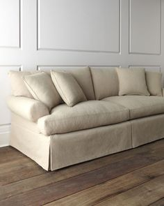 """""""Keystone"""" Sofa overstuffed with dressmaker-style skirt, handcrafted engineered hardwood frame with feather/down fill seat cushion 99""""W X 40""""D X 38""""T  $1,999 HC"""