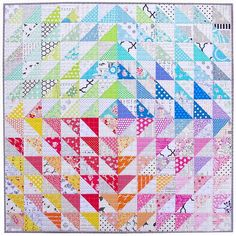 Rainbow Half Square Triangle Quilt - Red Pepper Quilts http://www.redpepperquilts.com/2014/04/a-rainbow-half-square-triangle-quilt.html