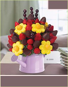 Edible Arrangements, love the watering can one for Mother's Day