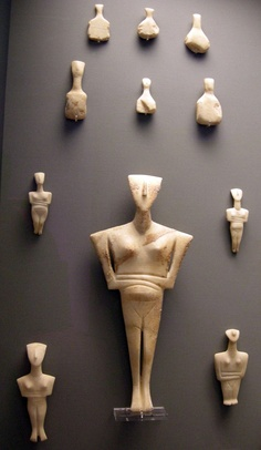 Collection of marble Cycladic Figurines, Cycladic Islands, 2300 BC, Early Bronze Age. British Museum. Conical collection. style: folded arms, standing on toes, long noses - they come in all sizes. Usually found in graves. Purpose unknown. Appear to be made for lying flat. All conical shaped figurines are female. Large figurine is pregnant, & some have lines across their stomachs to show child birth. We have no written evidence for purpose since this was a preliterate society