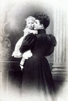 Queen Alexandra holding her grandson, Prince Edward, later Edward VIII.