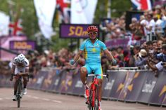 Alexandr Vinokurov of Kazakhstan celebrates crossing the finish line to win the Men's Road Race Road Cycling on day 1 of the London 2012 Olympic Games on July 28, 2012 in London, England.