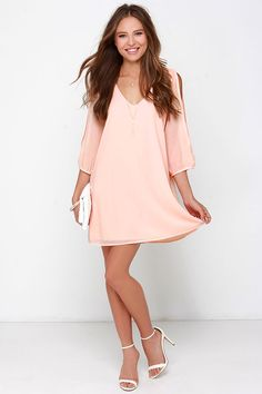 When it's time to shift your gears into glamor mode, the Shifting Dears Peach Long Sleeve Dress is our most dearly beloved dress! Peach Georgette forms a roomy shift silhouette with a deep, scoop neckline and a flared shape that flows into an asymmetrical, concave hemline. Long, sheer sleeves have on-trend, cold shoulder cutouts that open all the way to the cuffs.