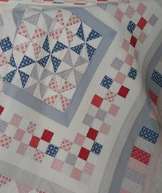 Red and Blues... with pinwheels and checkerboard border... beautiful summer quilt