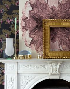 Create a visual display with a mix of modern and traditional florals in your living room.