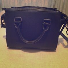 Steve Madden Black Satchel/Crossbody Black Steve Madden / Zipper close on top / Inside Zipper compartment / Two cell Phone Pockets. Used twice But in still in NEW SHAPE! Long strap to be Crossbody Steve Madden Bags Crossbody Bags
