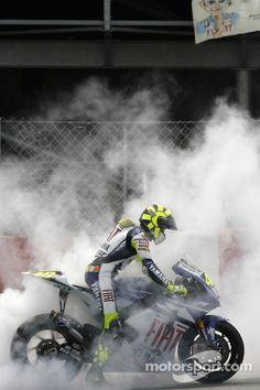 Second place Valentino Rossi does a burnout. Photo by Yamaha Motor Racing on November 2011 at Catalan GP. Valentino Rossi Yamaha, Valentino Rossi 46, Pink Motorcycle, Bobber Motorcycle, Racing Motorcycles, Beast Mode, Bengalischer Tiger, Moto Wallpapers, Biker Photography