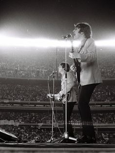 The Beatles at Shea Stadium, Aug. 1965. I still remember seeing this on TV. You couldn't hear them at all over the screaming fans.