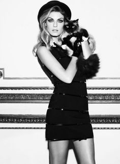 kitty cat . black dress and hat to die for