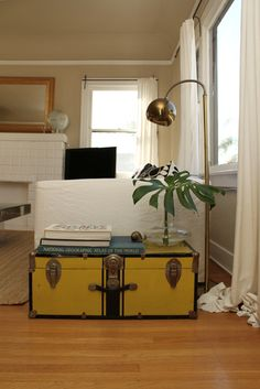 hard to find: vintage yellow suitcase. so cute.
