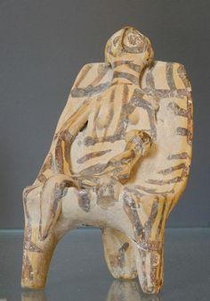 Kourotrophe phi-figurine Louvre. Phi-figurine of a woman holding a child. Terracotta, Late Mycenaean IIIA (ca. 1360 BC). From Mycenae.
