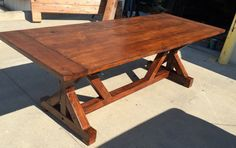 """This beautiful outdoor dining table will look amazing in your home! This table features a gorgeous modern knotty pine wood. Here at OnPoint Wood Design we handpick all of the wood planks for your furniture. The table comes sanded smooth with your choice of a natural, painted or stained finish.  DIMENSIONS This is a custom order form for a trestle farm table with benches. The dimensions of this table will be 66x33x31. Also available in 60, 72, 96, 108"""", 120"""" and 132"""" lengths. Tables Widths…"""