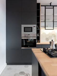 Grande cuisine avec lot central dans un appartement haussmanien haussmanien moderne - Mode keuken deco ...