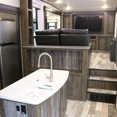 """Milestone RVs have enduring structure, value-driven Luxury, and aggressively low prices that are sure to impress even the most frugal RV buyer. Our Innovation is key to creating the best RVs around. Features such as Anti-microbial Solid Surface Kitchen Countertops, Friction Hinge 30"""" Entrance doors, Quad Aluminum steps, six foot five inch Slideouts, 4-5 Slideout Floorplans, Industry leading Exterior Graphics"""