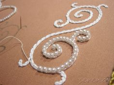 detail of a work in progress Nether thought of chaining under beading makes sense with pearls