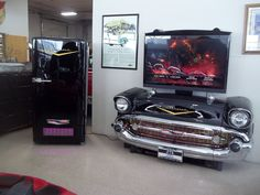 If you are a true Chevy enthusiast check out this beautiful 57 BelAir TV Display! Order now and be the first of your friends to show off this incredible piece! Car Part Furniture, Automotive Furniture, Automotive Decor, Garage Furniture, Garage Art, Man Cave Garage, Garage Interior, Garage Signs, Garage Ideas