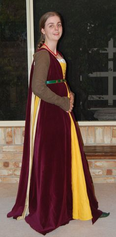 1480. A burgundy velveteen giornea lined in gold silk over the yellow linen dress with olive linen sleeves. All handsewn except for some hidden stitching on the giornea.