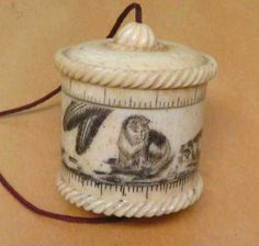 Bone cat tape measure. This is a delight especially as the decoration is a cat!