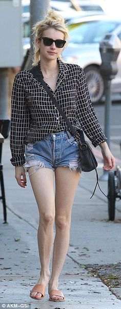 Flattering:The 25-year-old Scream Queens actress put her slender gams on full display in a pair of very short, ripped Daisy Dukes