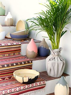 drip paint planters... maybe... not sure if this would work well with out pottery paint and being able to fire it after...