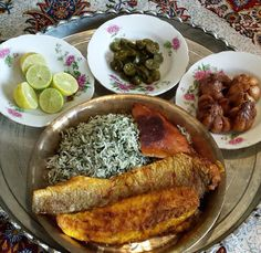 Sabzi Polo mahee Dill rice with fried fish Iranian food