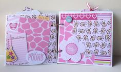 This is a beautiful little album for a new baby girl. Give it as a gift for a newborn, or fill it with photos of your own little bundle of joy. Pictures of a sweet little girl will be treasured for years to come in this little book. The album measures 6x6 inches and includes 6 pages, embellished on each side for a total of 12 sides, plus fold-outs and pockets. There are spaces for over 20 photos or journaling spots -- all you have to do is add your pictures! The album includes sweet…