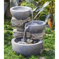 Bring your home the serenity of nature with this rock and stone floor fountain. Water flows from three pots to create a peaceful and placid environment in your garden.