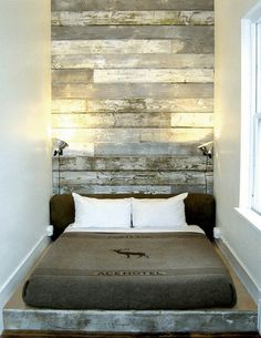 rustic wall and ceiling treatment | worn wood head board goes all the way to the ceiling.