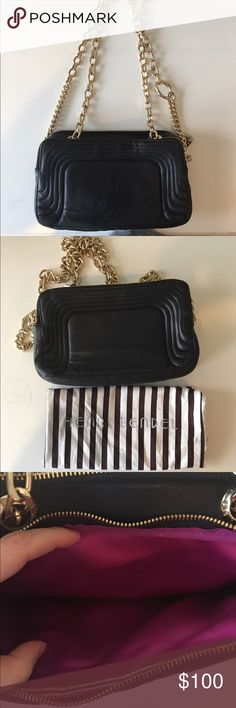 Henri Bendel Bag Black leather bag with gold chain that can be worn as a Messenger Bag and shoulder bag. Previously worn but in great condition! Has two openings with interior zipper closure and mirror. Open to reasonable offers through feature! henri bendel Bags