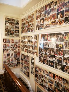 Family photos line the upper floors of the stairwell.