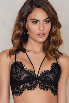 Nothing is hotter than black lace! Raw Edge Double Strap Bra by NA-KD comes in black and features flower lace, strap details at front, fastening at back with one hook and eye. Wear it under an oversized shirt!