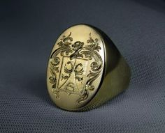 Family crest hand engraved on gold signet ring